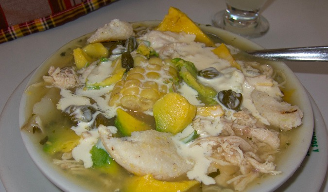 Delicious Colombia traditional food with corn and cream sauce