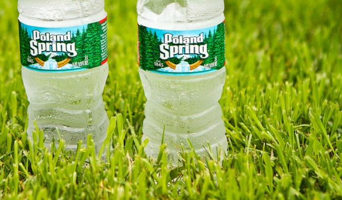 Two bottles of water in the green grass