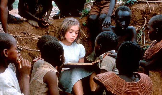 girl in nowhere in africa reading to african children
