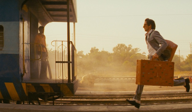 man running after a train in India movie called the darjeeling limited