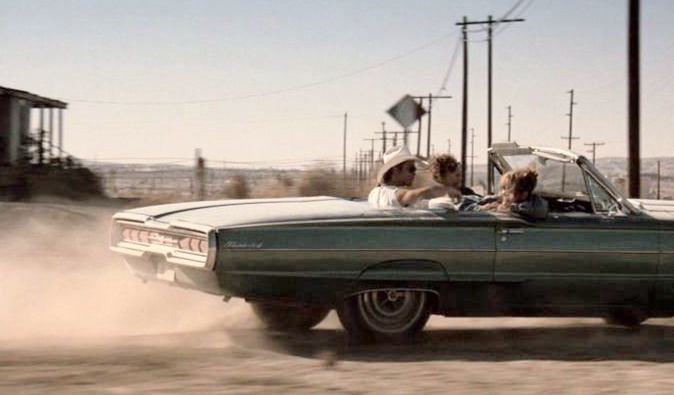 Thelma and Louise riding off famously in their convertible car
