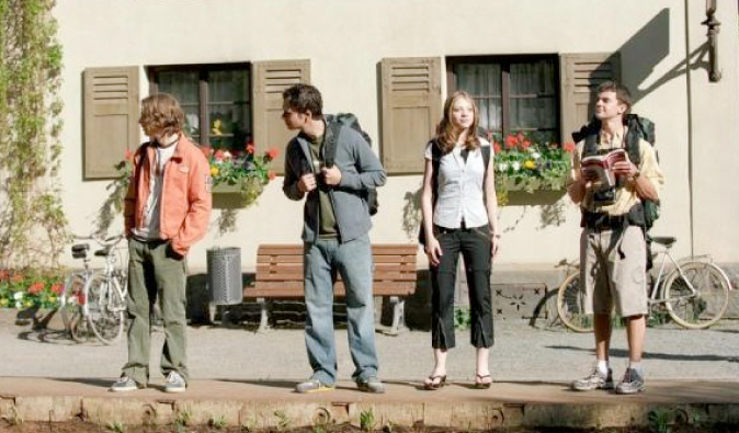 Backpackers on a European street in the movie Eurotrip