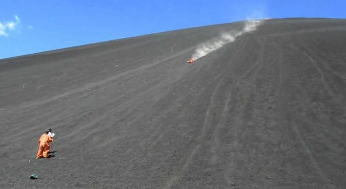 Travelers volcano boarding down Cerro Negro in Nicaragua