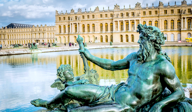 Statue near fountains at Versailles in Paris, photo by Carlos Reusser (flickr: @carlosreusser )