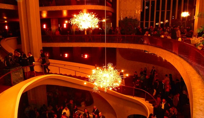 The stunning interior of a popular theater in New York, complete with impressive chandeliers