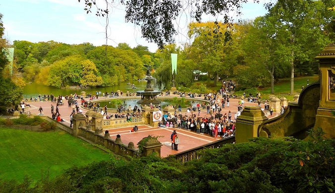 A view of the fountain in the center of Central Park in Manhattan on a sunny summer day