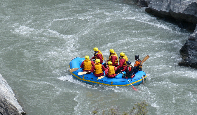 A group of travelers white water rafting in New Zealand
