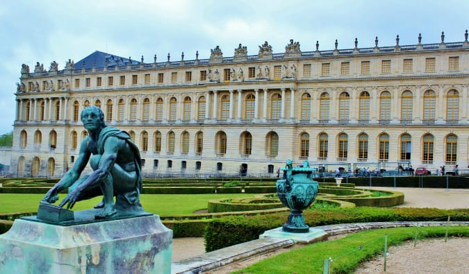 The statues and beautiful facade of the Palace of Versailles in France