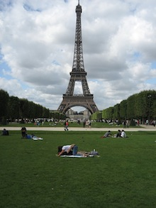 Lovers on the ground in front of the Eiffel Tower in Paris