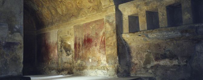 The ancient art on the walls of the Stabian Baths in Pompeii