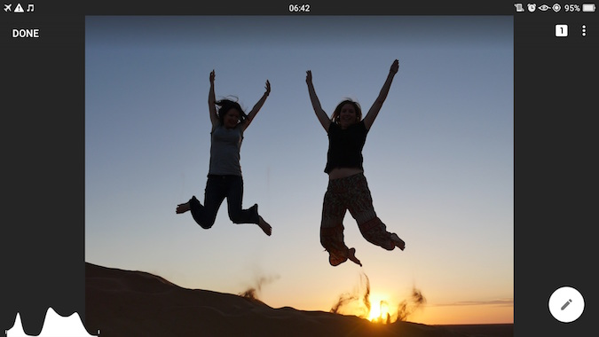 Girls jumping on sand dunes - original photo