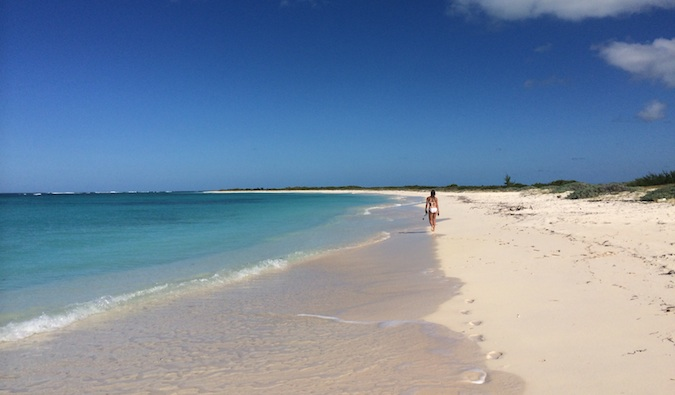 walking down a beach in the exclusive BVIs