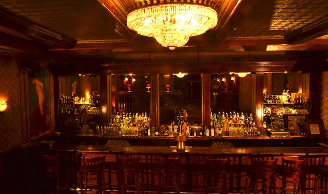 The Back Room has an elegant bar with a grand chandelier overhead, the perfect atmosphere for a prohibition bar