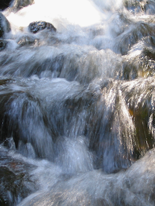 A gushing waterfall flowing freely