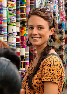 Elise from positive world travel dividing up the shopping in a fabric store overseas