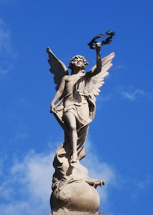 statue on top of the national theater