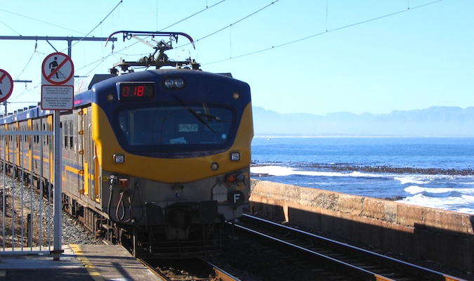 yellow train riding through south africa