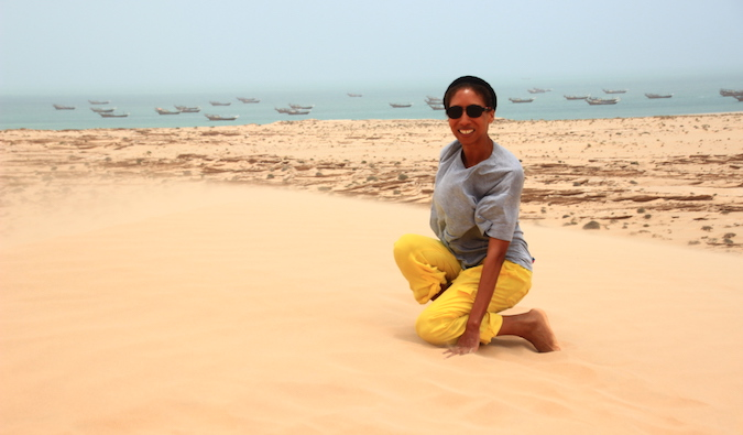 Teacher in Saudi Arabia poses on sand dune