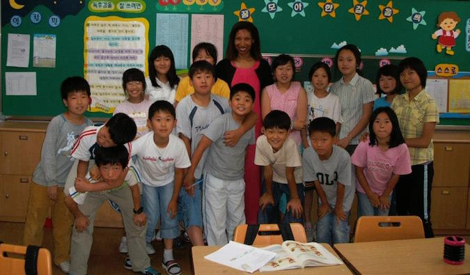 ESL teacher in South Korea with her elementary school students