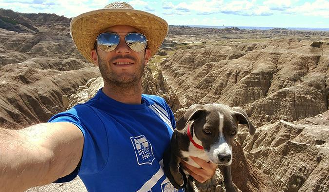 Scott Keyes posing with his dog