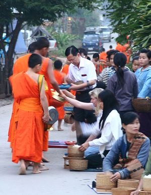 alms giving in southeast asia
