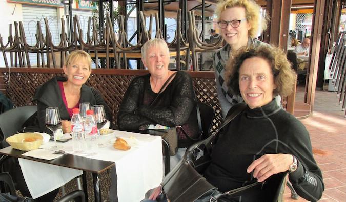 Older female travelers meet up overseas
