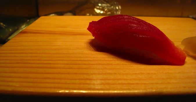 A single piece of sushi served on a wooden platter at Nobu, in Las Vegas