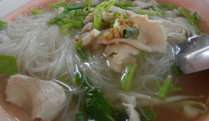 White noodles in chicken soup
