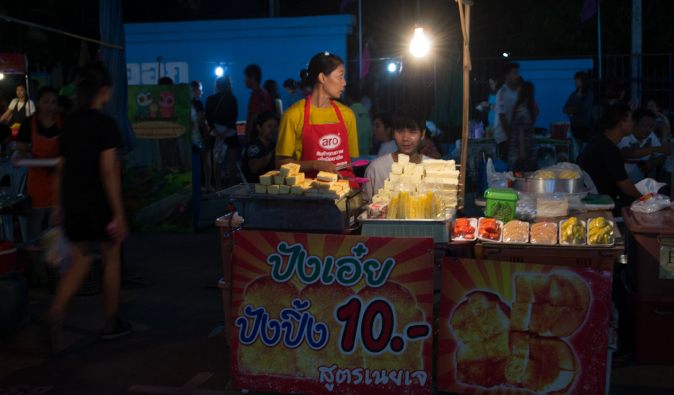 pad thai making street stall in the night market bangkok