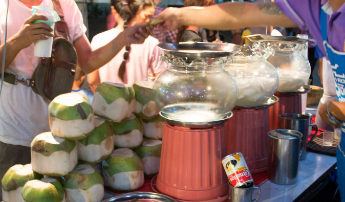 thailand's coconut drink and fresh coconuts sold on the streets