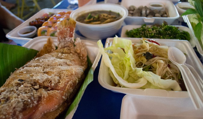 fried fish, noodles, pad thai and other thai street food, dinner at the market in Bangkok