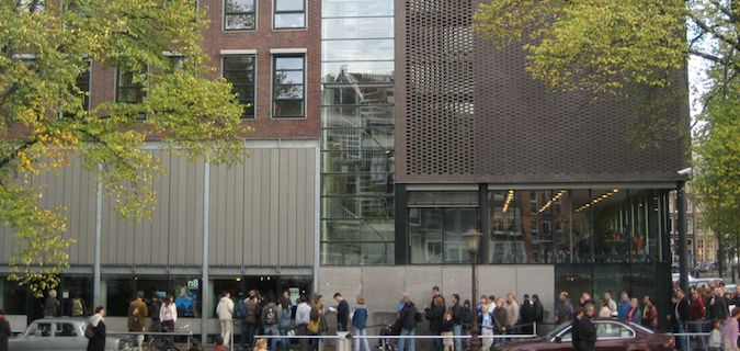 Anne Frank House with a line outside of it in Amsterdam