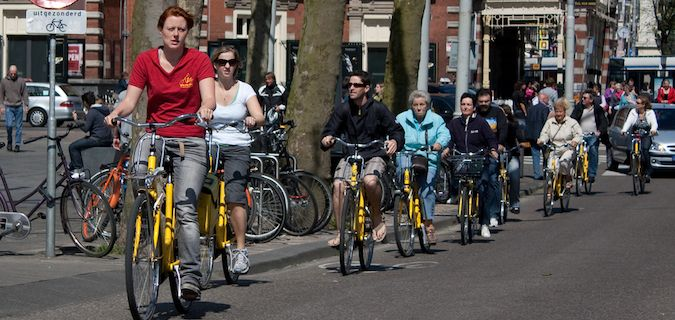 Group on a bike tour through a city in The Netherlands
