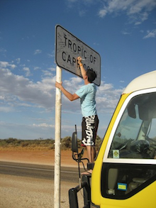 writing my name on the Tropic of Capricorn sign while standing on a bus