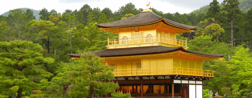 The famous golden temple on with its lake in the city of Kyoto, Japan