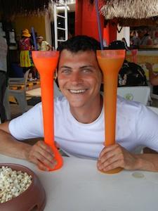 Nomadic Matt drinking on his cruise vacation