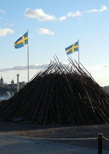 fire pit at valborg day with swedish flag