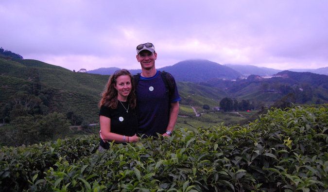 Sean and Dawn from Wandering Why in a field in Southeast Asia