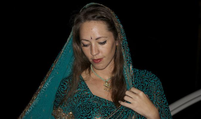 a female traveler in a sari