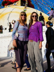 solo female travelers in front of tents