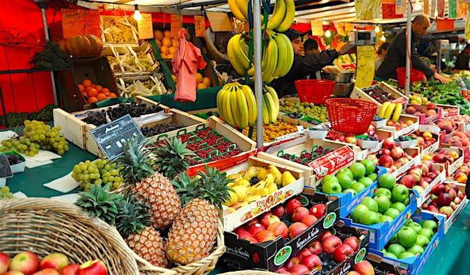 visit a local market to save money on food