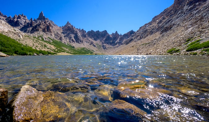 Calm waters in a valley near Refugio Frey on a bright and sunny day