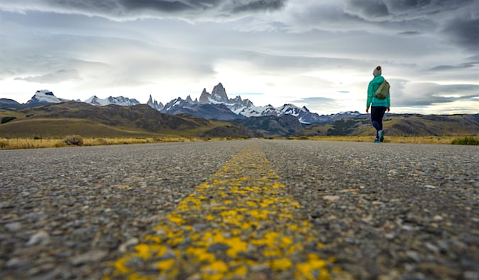 Standing on the Ruta 40 just outside of El Chaltén in Patagonia with mountains in the distance