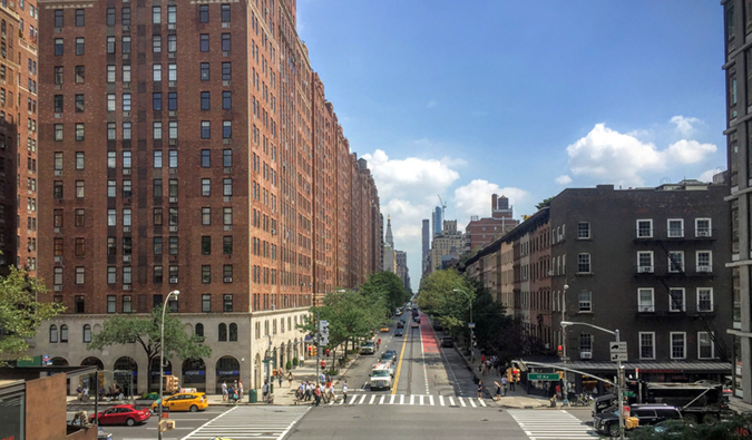 Street view of Chelesa, NYC with an empty street on a summer day