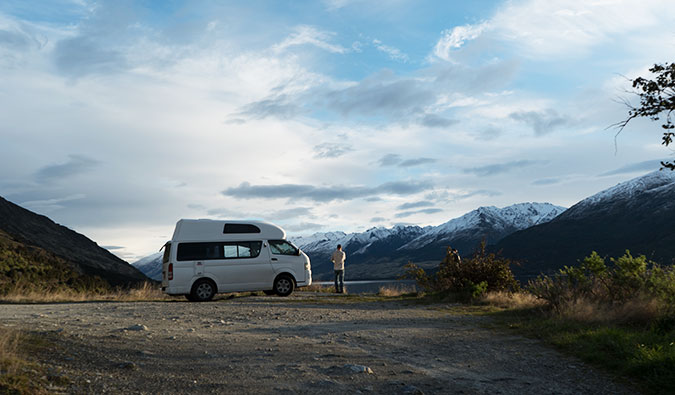 A campervan on Wanaka Lake in New Zealand