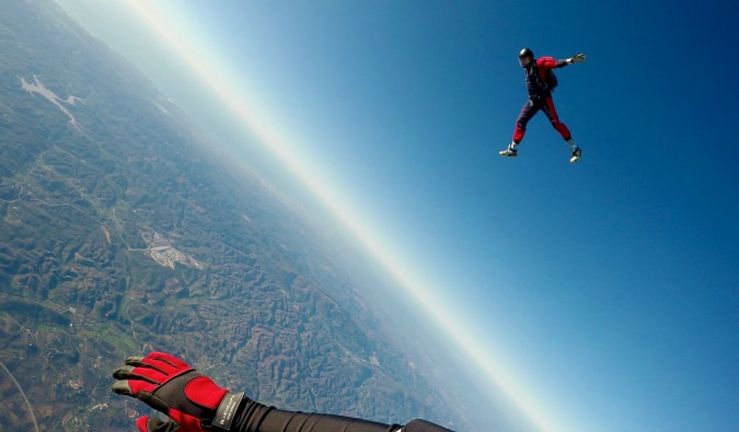A traveler skydiving from an airplane solo