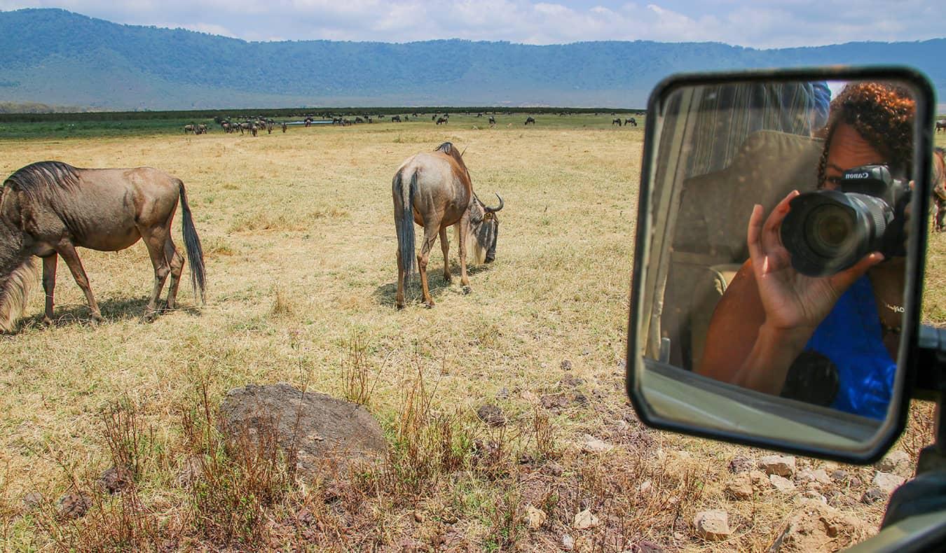 Heather on safari in Africa taking photos of animals