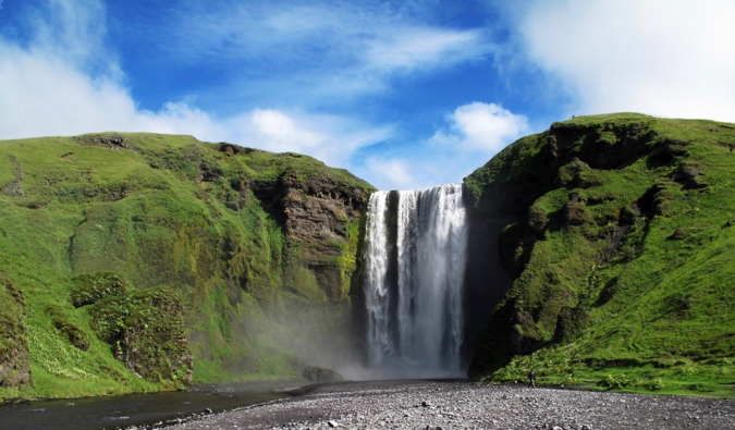 the huge waterfall Skogafoss in Southern Iceland