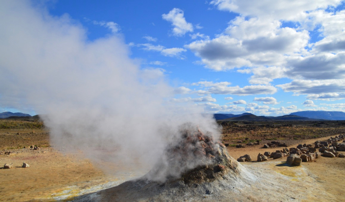 A smoky pile of rocks at the Hverir geothermal area