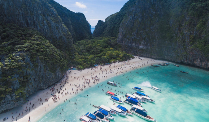 a crowded beach on Koh Phi Phi in Thailand
